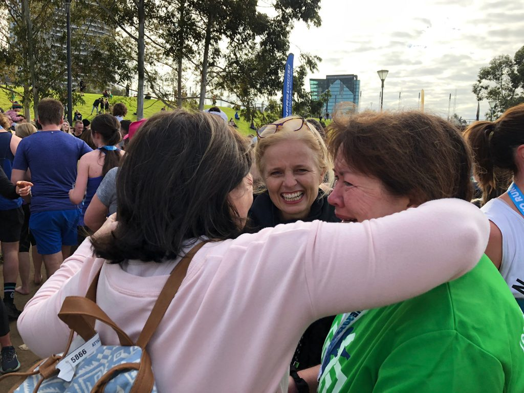 Pam being welcomed by Robbie, Di & Mel at Run Melbourne 2019